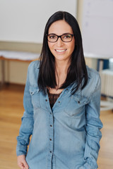 Pretty young dark haired woman wearing glasses