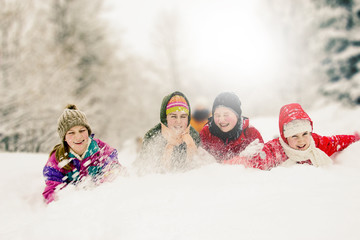 Group of happy children enjoying in winter
