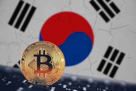 Bitcoin. Bitcoin on the background of flag South Korea ban.