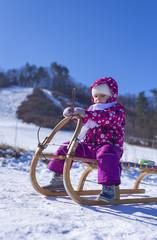 Little girl enjoying a sleigh ride