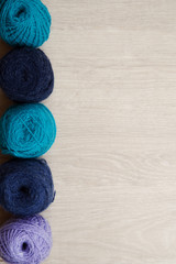 Colored balls of wool from left side. With background space
