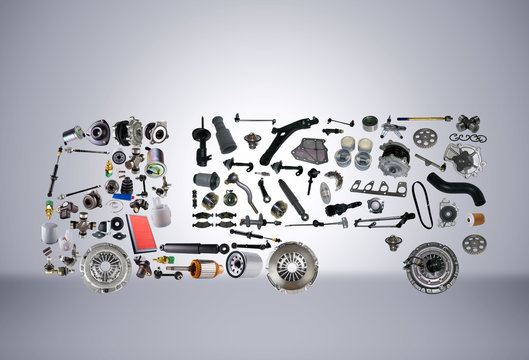 Images truck assembled from new spare parts on grey background. Truck with a trailer and with cargo