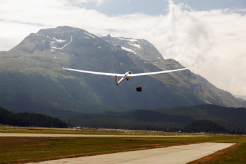 A view of a flying glider in the airport of St Moritz in the alps switzerland