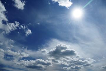Natural bright sun on dark blue sky