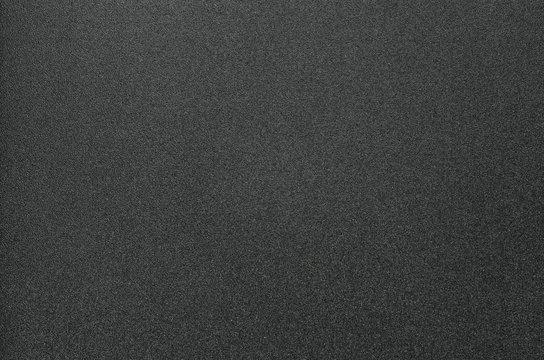 Grainy Texture of Black Plastic for Office Folders. Black Grainy Plastic Background Close-Up