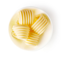 Butter curls isolated on white, from above
