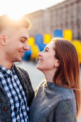 Couple spend time with each other, stand on the street and kiss
