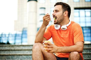 Man is eating fruit salad