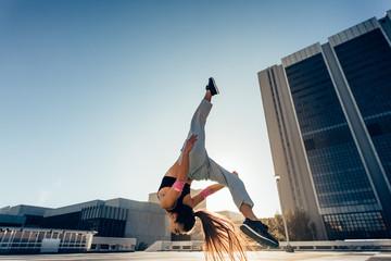 Urban woman performing a flashkick