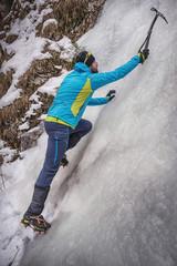 Climber on a frozen waterfall