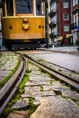 Old yellow city tram and tramway close-up