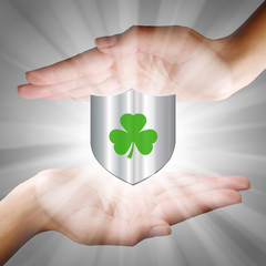 Hands Holding a Shield - Shamrock
