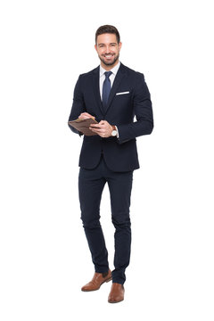 Young positive caucasian businessman holding clipboard isolated