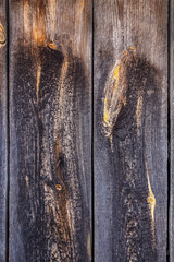 natural wood boards with beautiful texture. Barn wood wall with old, natural, rough boards. Wall texture background pattern. Wooden boards, boards are old with a beautiful branch pattern, style.