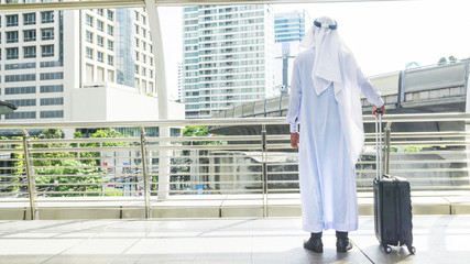 arab man carry a suitcase at business city