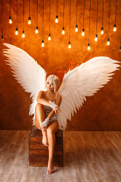 portrait of beautiful woman with white angel wings on