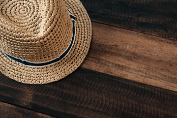 straw hat on a wooden table with copy space.