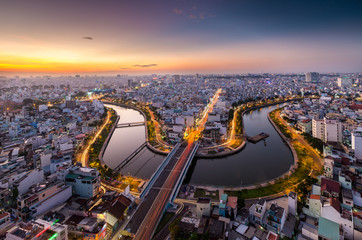 HO CHI MINH, VIETNAM - NOV 20, 2017: Royalty high quality stock image aerial view of Ho Chi Minh city, Vietnam. Beauty skyscrapers along river light smooth down urban development in Ho Chi Minh City