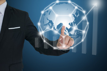 Businessman touching global  network and Financial charts showing growing revenue. communication and social media concepts.