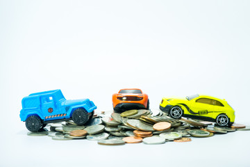 Car toy with coin money on white background