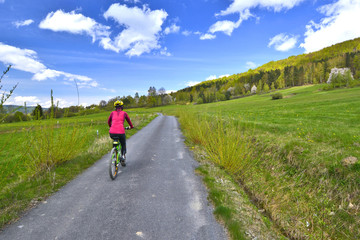 Woman  riding a bicycle on a sunny spring day