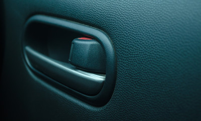Close up car door opening handle.