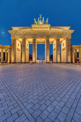 The famous illuminated Brandenburg Gate in Berlin early in the morning