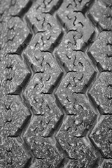 Used tire detail. Damaged wheels. Vehicle parts. Danger