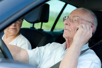 senior man driver calling at the same time