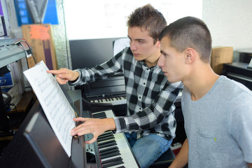 young men with an electric piano