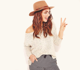 Portrait of young stylish girl model in casual summer clothes in brown hat with natural makeup in glasses isolated on white background. Looking at camera and showing peace sign