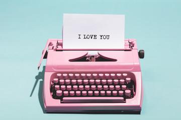 """I love you"" writing and pink typewriter."