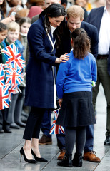 Britain's Prince Harry and his fiancee Meghan Markle meet local school children during a walkabout on a visit to Birmingham