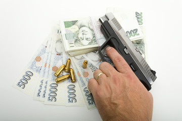 gun and czech banknotes, crime concept