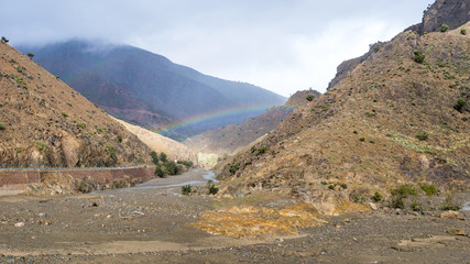 Rainbow in a gorge, Tizi N'Tichka pass in the Atlas Mountains, Al Haouz Province, Marrakech-Safi region, Morocco, North Africa, Africa