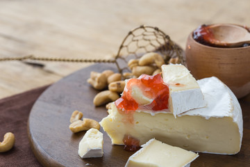 Brie cheese. Camembert cheese. Fresh Brie cheese with herbs and cranberry Brie cheese. Camembert cheese. Fresh Brie cheese