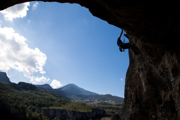 the rock-climber on a route with the lower insurance