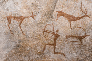 An image of an ancient man's hunting on the wall of a cave. ancient world history.
