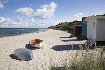 Boats and beach huts on white sand beach with town behind, Tisvilde, Kattegat Coast, Zealand, Denmark, Scandinavia, Europe