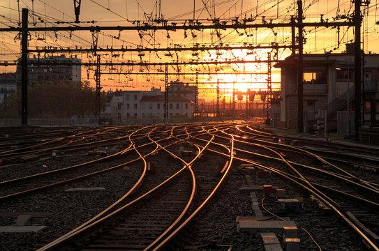 Empty railroad tracks during a nice sunrise at Gare de Lyon-Perrache. Lyon, France.