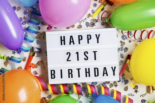 Happy 21st Birthday Celebration Message On A Lightbox With Balloons And Confetti