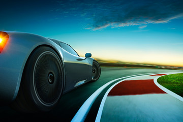3D rendering of a brand-less grey sport car with  motion blur . Race track background . Sunset scene .