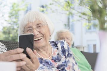 Senior woman looking at smartphone