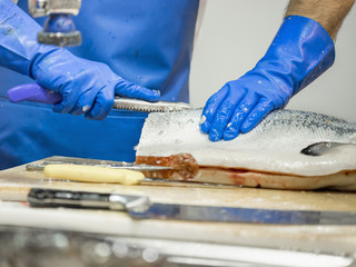 Man preparing fish with knife