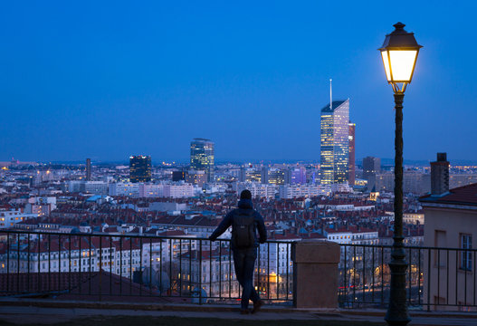 Man looking over the 6e arrondissement  from a park in Croix Rousse. Lyon, France.