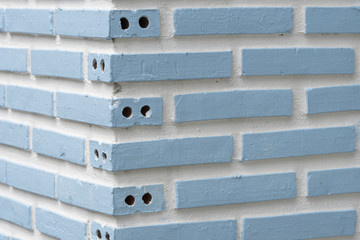 Detail of a blue brick wall texture white background