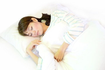 Portrait of the beautiful asian young woman sleeping in white bed