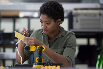 Female working on robotics