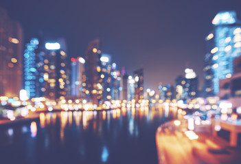 Color toned blurred picture of Dubai Marina at night, modern urban background, United Arab Emirates.