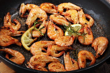 Grilled shrimp skewers. Seafood, shelfish. Shrimps Prawns skewers with herbs, garlic and lemon.